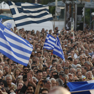 Protesters wave Greek flags during a massive peaceful rally against austerity measures on Tuesday, May 31, 2011. About 25,000 people take part in the protest organized by university teachers. European officials are locked in a heated debate over whether _ and how _ to give more aid to debt-ridden Greece just as a much-delayed examination of the country's finances draws to a close. (AP Photo/Thanassis Stavrakis)