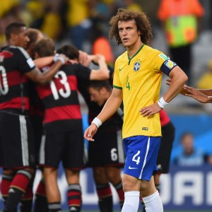 BELO HORIZONTE, BRAZIL - JULY 08:  David Luiz and Maicon of Brazil react after allowing a goal during the 2014 FIFA World Cup Brazil Semi Final match between Brazil and Germany at Estadio Mineirao on July 8, 2014 in Belo Horizonte, Brazil.  (Photo by Laurence Griffiths/Getty Images)