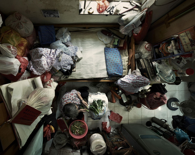 """Editorial Use Only. No stock, books, advertising or merchandising without photographer's permission Mandatory Credit: Photo by Benny Lam/SoCO/Rex / Rex USA (1254664d) (Cropped picture) An elderly person living in urban slums in Hong Kong. Shocking aerial photos of cramped Hong Kong apartments, Hong Kong - 22 Feb 2013 FULL COPY: http://www.rexfeatures.com/nanolink/k4y9  For people living in the west, it's hard to imagine anyone living in an apartment this small. But for some of the poorest people in Hong Kong this is their home, all 40 square-foot of it.  The Society for Community Organisation (SoCO) has released a set of birds-eye images of low-income families, singletons, elderly and unemployed people living in urban slums to highlight the housing problem in Hong Kong. Director of SoCO, Ho Hei-Wah says: """"By taking these photos of inadequate housing we have uncovered the problems and want to arouse public and government concern over the issue. """"These people have to afford an expensive rent rate; it equals to approximately GBP 6-7.50 per square foot per month and sometimes have to wait years for public rental housing because they have so few in Hong Kong."""""""
